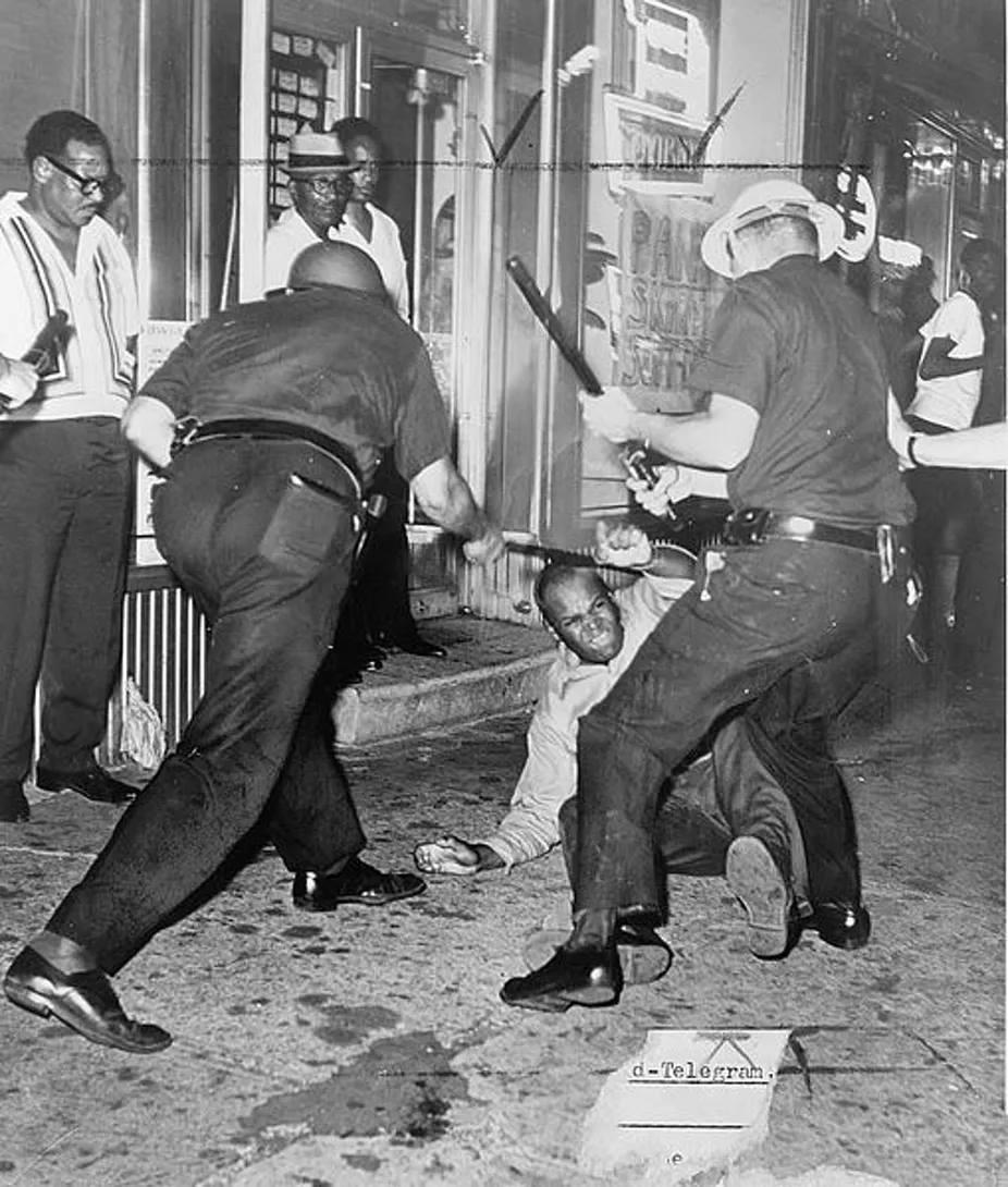 Cops beating a Black man.jpg