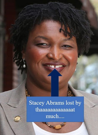 stacey-abrams-lost-tooth.jpg